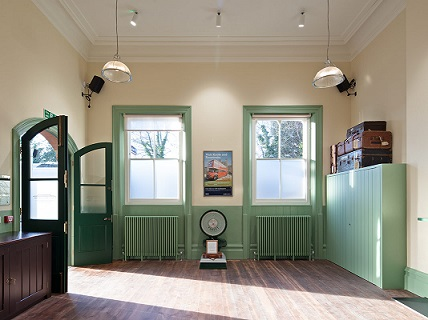 Interior view of waiting room at Bat and Ball Station - doors open
