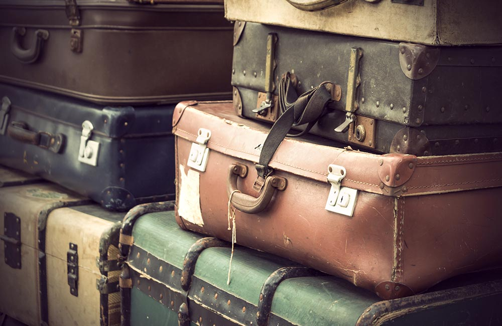 Pile of Vintage Leather Suitcases in various colors